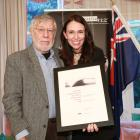 Alexandra poet Michael Harlow is congratulated by Prime Minister Jacinda Ardern on receiving the...