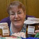 Fundraiser Sheila Broderick shows some of her wares at the Labour Party conference in Dunedin....