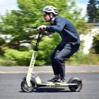 Otago Daily Times reporter Tim Miller gains a full head of speed while taking an e-scooter for a...