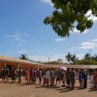Voters in Montravel, New Caledonia, line up to cast their vote in the independence referendum....