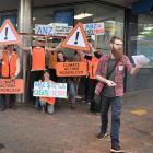 Supporters of climate activism group 350 Dunedin, who marched to an ANZ branch yesterday to...