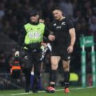 Williams is escorted off the Twickenham pitch by Dr Tony Page. PHOTO: Getty Images