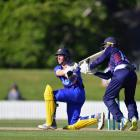 Otago Volts all-rounder Nathan Smith plays a sweep shot during his innings of 43 in the Shell...
