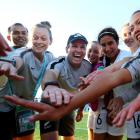 Coach Leon Birnie celebrates with the team after their win over Japan. Photo: Getty