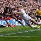 New Zealand's Jamayne Isaako dives for the corner in the tackle of England's Tommy Makinson....