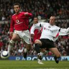 Giuseppe Rossi (left) challenges Chris Perry for the ball as Cristiano Ronaldo looks on in the...
