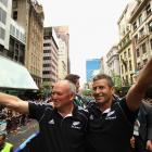 Graham Henry (left) and Wayne Smith celebrate at the parade in Auckland after coaching the All...