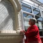 Southland researcher Ann Robbie reads the names of the former Makarewa Presbyterian Church...