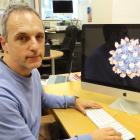 University of Otago researcher Dr Mihnea Bostina looks at a Seneca Valley Virus attached to its...