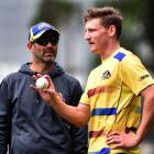 Otago coach Rob Walter gives all-rounder Nathan Smith a few instructions during a training...