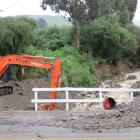 Mud, gravel and debris was removed from a creek beside Quail Haven, Roxburgh. Photos: Staff...