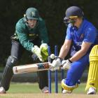 Volts batsman Shawn Hicks and Stags Wicketkeeper Ma'ara Ave watch as the ball flies onto the...