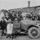 """Armistice Day celebrations at Owaka: A car in the procession containing the """"Mayor'' and local..."""