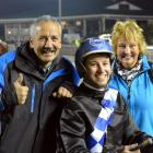Phil Williamson (left) with son Brad and wife Bev after Winners Shout gave Williamson his 50th...