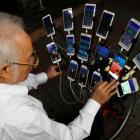 """Taiwanese Chen San-yuan, known as """"Pokemon grandpa"""", plays the mobile game """"Pokemon Go"""" by..."""