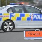 Stock photo of a police car and ambulance at the scene of a crash. Photo: Gerard O'Brien