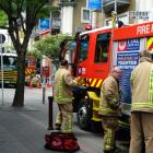Firefighters at the scene of the laundry fire in Stratton House, Queenstown this afternoon. Photo: Josh Walton