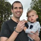 Jono Bredin and son Nixon at home this week. Photo: Gregor Richardson