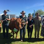 Blenheim police constable Richard van Asch (second from left) was pleased to win the supreme...