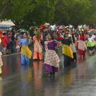 The Filipino Waitaki Inc entry at the Waitaki District Santa Parade makes its way down Thames St...