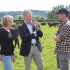 Agriculture and Biosecurity Minister Damien O'Connor (centre) talks with dairy farmers Anne-Marie...