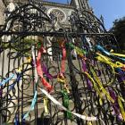 Ribbons of remembrance from around the world were tied on the gates of St Joseph's Cathedral in...