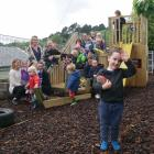 Archie Thor­burn (3) and other Macandrew Bay Playcentre children and parents enjoy the new...
