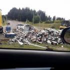 A section of the roundabout was temporarily blocked as a digger was helping the truck driver...