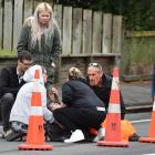 Members of the public assist a man after he was seriously assaulted in a road rage incident in...