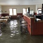 Floodwater in the Tap and Dough Bistro in Middlemarch earlier this week. Photo: Supplied via RNZ