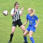 Northern's Ava Pritchard (left) and Southern United's Emily Morison in action during their...