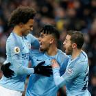 Manchester City's Gabriel Jesus (C) celebrates with Leroy Sane (L) and Bernardo Silva after...