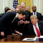 President Trump speaks with his son-in-law and senior White House adviser Jared Kushner at a bill...