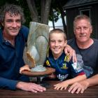 Jed Crawford, 10, flanked by Arrowtown sculptor Conor McNicholas, left, and his rugby coach Dean...