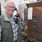 Teviot District Museum committee member Robin Christie displays the old telephone exchange used...