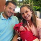 Robson Pacheco and Daiane Brazil Foggiato cradle their Christmas Day baby, Elena, who was born at...