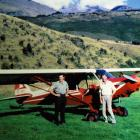The author's father (left) takes delivery of his new plane in the mid 1960s.  The hillside in the...