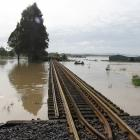 The railway line surrounded by water near Balclutha yesterday morning. Photo: John Cosgrove