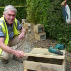Helping construct little blue penguin nesting boxes is one of 20 events comprising the Forest ...