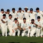 The Black Caps pose with the trophy after winning The Third Test match between New Zealand and...