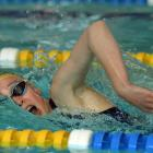 Zenith's Caitlin Hewson (12) swims in the 200m freestyle at the Otago swimming championships held...