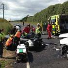 Paramedics had to pull a patient out of this car on Awhitu Rd yesterday. Photo: Auckland Rescue...