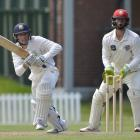 Otago's Cam Hawkins runs a quick single while Canterbury wicketkeeper Cameron Fletcher looks on...