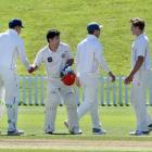 The Otago side congratulates Canterbury batsman Ken McClure yesterday morning at the conclusion...