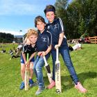 George Currie (left, 9) and twins Sam (centre) and Isabella Moore (8) enjoy a day out at the...