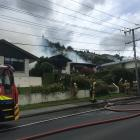 Firefighters battle a blaze in Oamaru this afternoon. Photo: Hamish MacLean