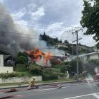 Firefighters battle a blaze which severely damaged a house in Oamaru this afternoon. Photo: Logan...