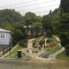 The front of this house in Ravensbourne turned into a torrent. Photo: Gregor Richardson