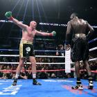 Tyson Fury (left) taunts Deontay Wilder during their WBC Heavyweight title bout. Photo: Getty...