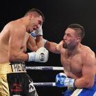 Joseph Parker (R) lands a punch on Alexander Flores. Photo: Getty
